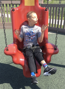 Special Needs Son on Swing